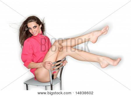 Coquettish Sexy Cute Woman In Pink Blouse With Long Legs Posing On Chair, Ring Flash Studio Portrait