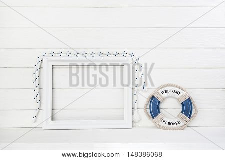 White wooden background with lifesaver in blue with a frame in mock up style.