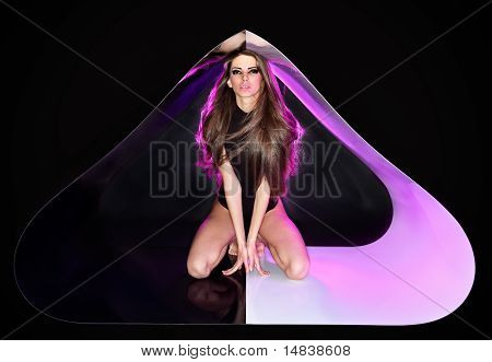 Young Slim Beautiful Lady With Long Hairs In Abstract Plastic Tube, Ring Flash Fashion Portrait