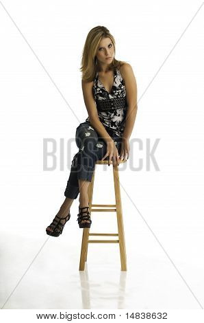 Pretty Young Blonde On A Stool