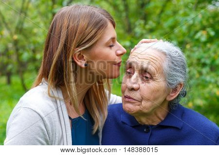 Portrait of a senior woman spending time with her granddaughter