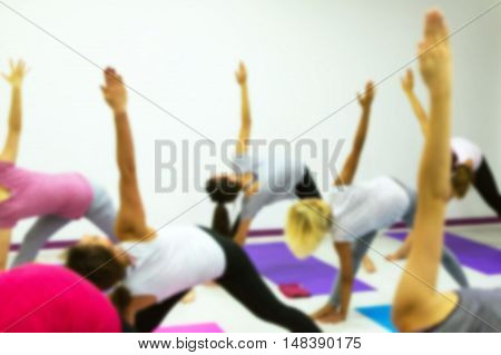 Group Of People Practicing Yoga At Health Club Blurred. Yoga, Sport, Fitness, Lifestyle And People C