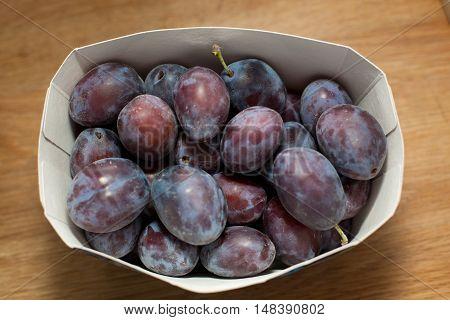 Prunes In A Cardboard Box.