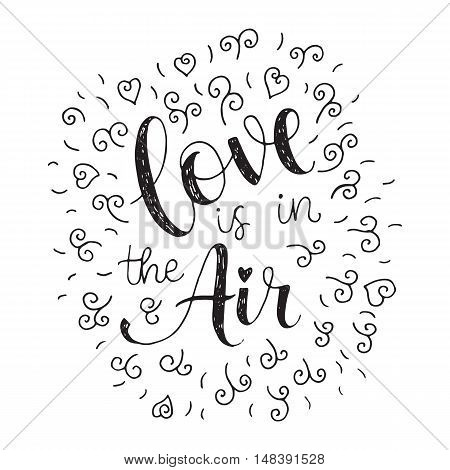 Love is in the air. Valentines day hand lettering greeting card.