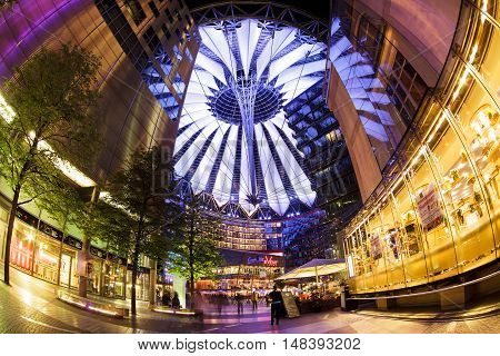 Berlin Germany - May 10 2013: The modern colorful glass roof of Sony center in Berlin at night time