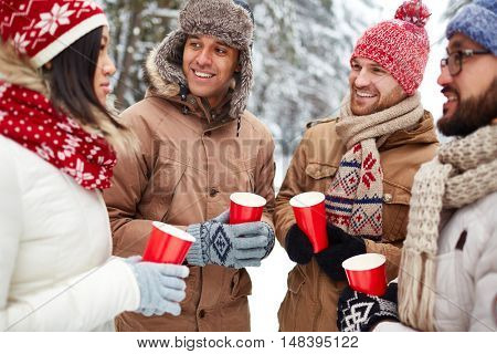 Friends with hot drinks