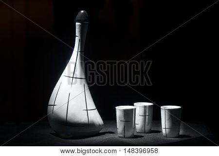 White porcelain jar on black background light brush in black and white