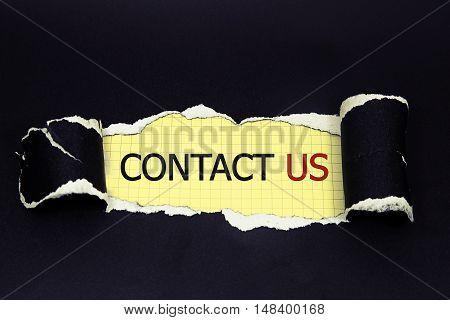 contact us word written under torn paper
