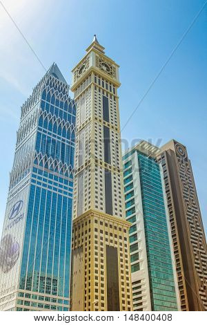 Dubai, UAE - May 1, 2013: Al Yaqoub Tower, Capricorn Tower, Al Rostamani Maze Tower on Sheikh Zayed Road in Downtown of Dubai. Emirates Towers, Trade Centre, Burj Khalifa and Dubai Mall are nearby.