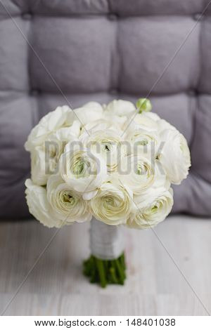 closeup of a white ranunkulyus and Peony buttercup wedding bouquet