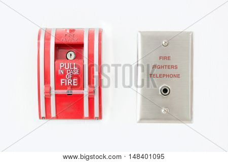Fire alarm push botton and fire fighters telephone on wall