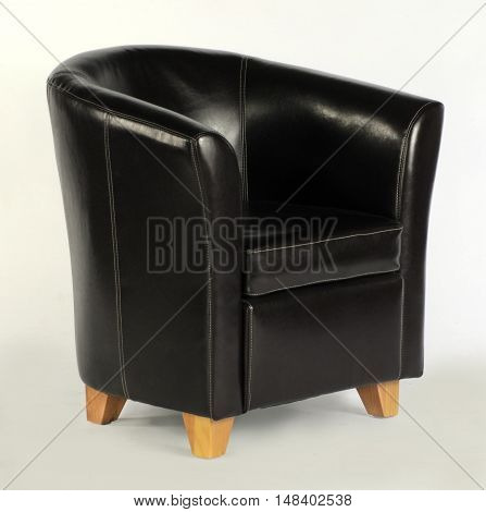 single black leather tub chair on white background