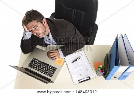 tired and frustrated businessman desperate face expression suffering stress worried with headache at office computer desk heavy work load overwhelmed and stressed isolated on white background