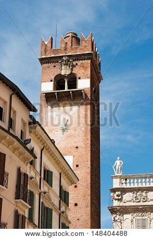 Torre del Gardello (Gardello Tower) XII century and Palazzo Maffei XV century. Piazza delle Erbe. Verona (UNESCO world heritage site) Italy