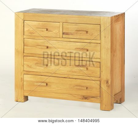 a single chest of drawers sideboard cupboard on a white background