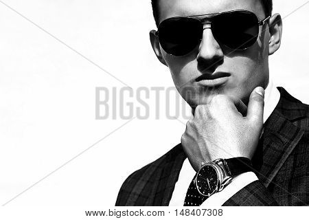 a handsome young man in sunglasses sunlit