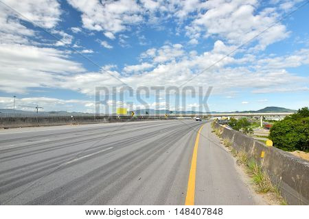 road with tyre tracks in cloudy day