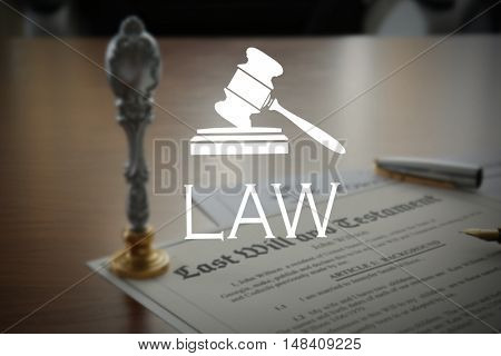 LAW. Metal stamp and documents on notary public table