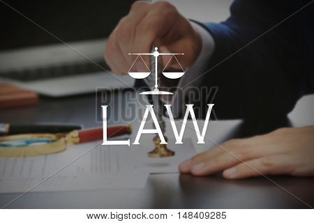 LAW. Notary public in office stamping document