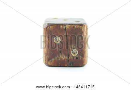 Old wooden dice on a white background