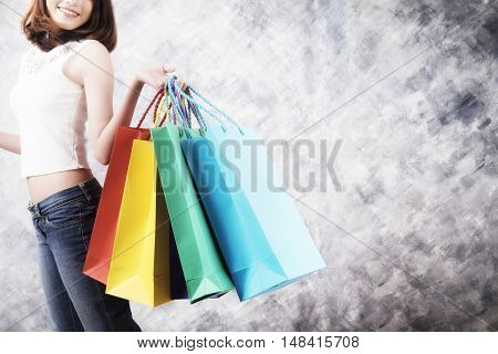 Asia woman holding shopping bags. Business concept idea.
