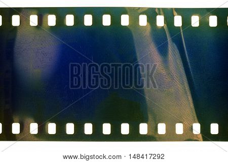 Blank crumpled noisy blue film strip texture background
