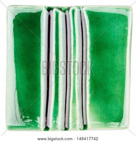 Green lined handmade glazed ceramic tile isolated on white background