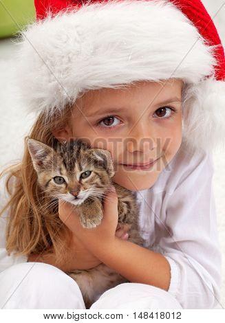 The best christmas present - little girl with her new kitten