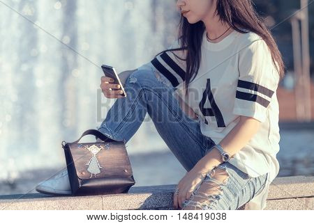 teenage problems sad girl reading a message on your phone