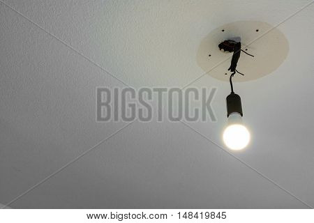 Light Bulb Hanging From Ceiling Illuminated Wire White Blank