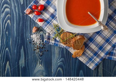 Pumpkin And Carrot Soup With Cream And Parsley On Blue Wooden Background Top View Copy Space