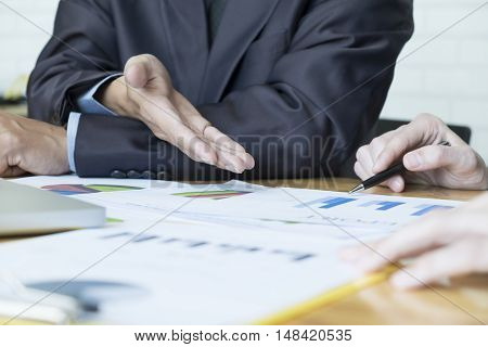 Business people meeting to discuss the situation on the market.