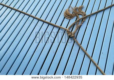 boat rope , rope knot on wood blue