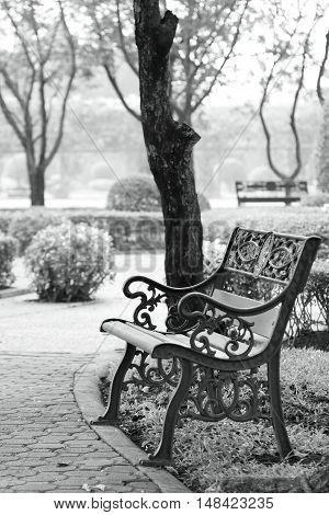 Park and ornate bench, Monotone photo. Black and White Composition.