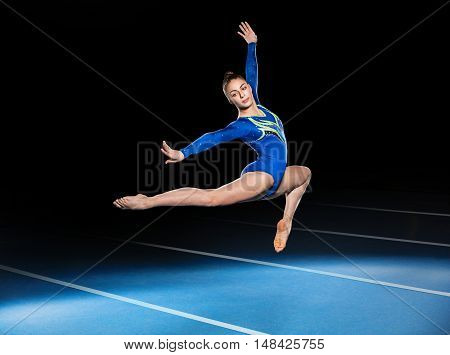 portrait of young gymnasts competing in the stadium retouched