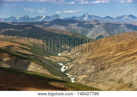 Mountain valley with river on the blue sky background