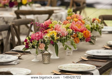 Dinner table with antique place settings for wedding reception