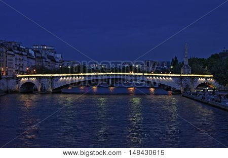 Tournelle bridge by night in Paris France - HDR