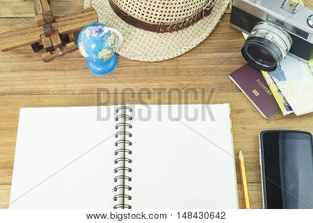 Copyspace of vintage travel concept on wooden background