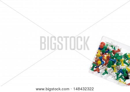 Color pins in box isolated on white background. Empty space for text. Office background concept.