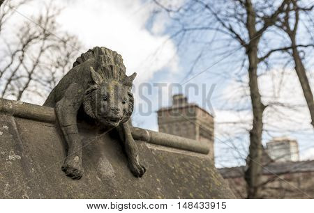 Hyena statue, on the walls of Cardiff castle, in Wales, UK