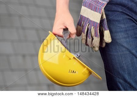 Worker in a construction site. Yellow helmet