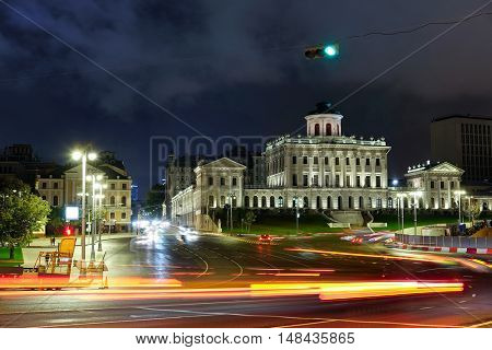 Night landscape with the image of Ohotniy riad - the street in a center of Moscow, Russia and Pashkov house. There is Lenin library in this house now