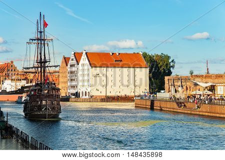 GDANSK, POLAND - SEPTEMBER 18, 2016: People at the quay port with many restaurants, view of Motlawa river in Gdansk. Old Town in Gdansk is a tourist attraction for visitors.