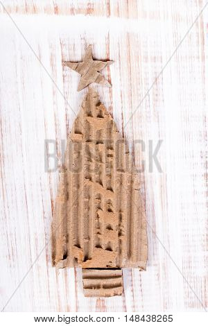 Christmas background with cardboard christmas tree on wooden background