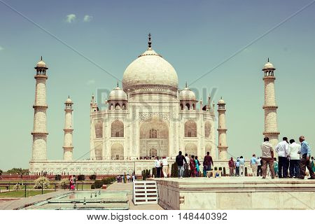 Taj Mahal on a bright sunny and clear day with tourists
