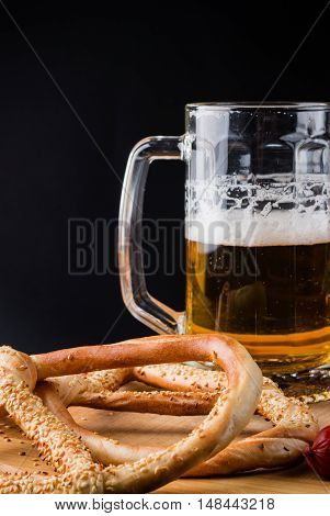 Glass Of Light Beer, Pretzels On Wooden Board, Background