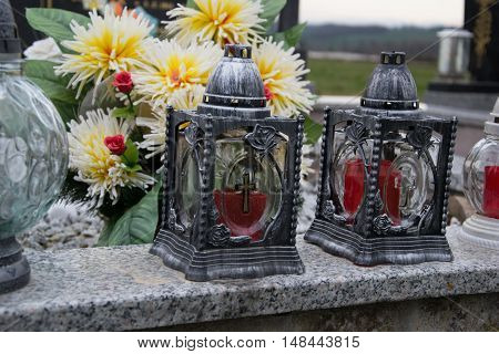 Votive Candles Lantern On The Grave In Slovak Cemetery. All Saints' Day. Solemnity Of All Saints. Al