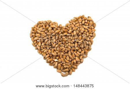Heart of wheat grains isolated on white background