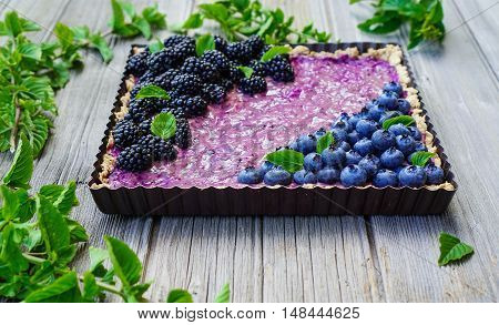 Homemade Vegan Gluten-free Banana Berry Tart/ Oatmeal Crust/ Healthy Dessert/Selective Focus